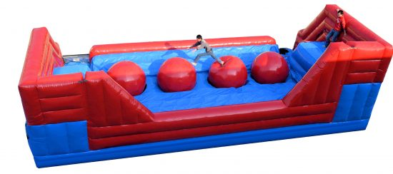 Giant Red Balls Wipe Out Leaps Bounds inflatable interactive game rental michigan