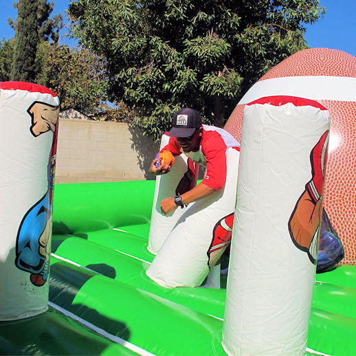 tugga touchdown bungee run interactive inflatable football game party rentals michigan
